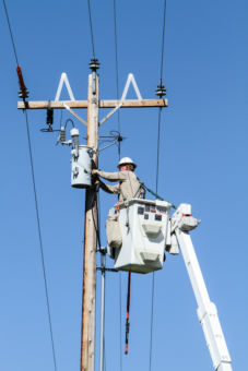 Lineman working in bucket truck