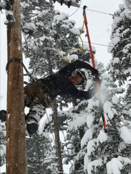 Linemen working in snow