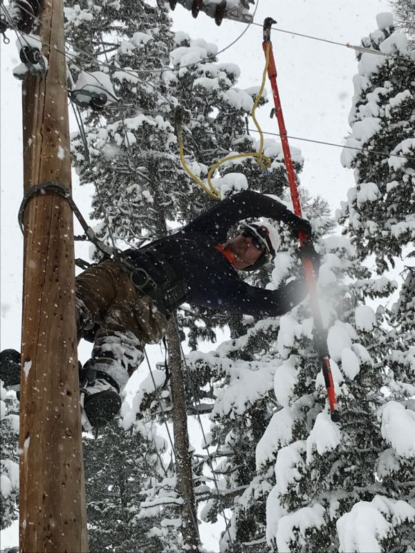 Linemen working in snow