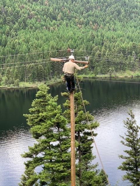 Foreman, Mitch Dupree, changing a cross arm at Salmon Lake.