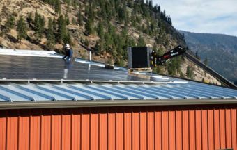 Travis Koehn with Jordan Solar sets solar panels on top of the K3 brewery in Bonner.